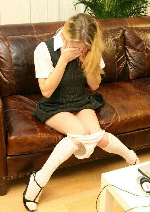 girl with her panties down, crying after her spanking