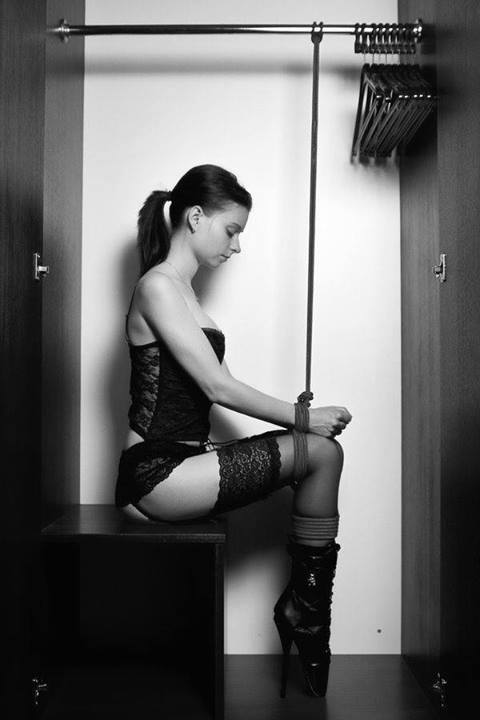Sexy slavegirl tied up in a closet