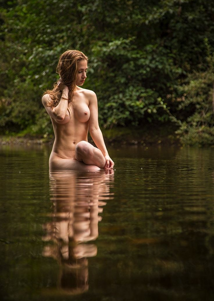 Naked girl skinny dipping