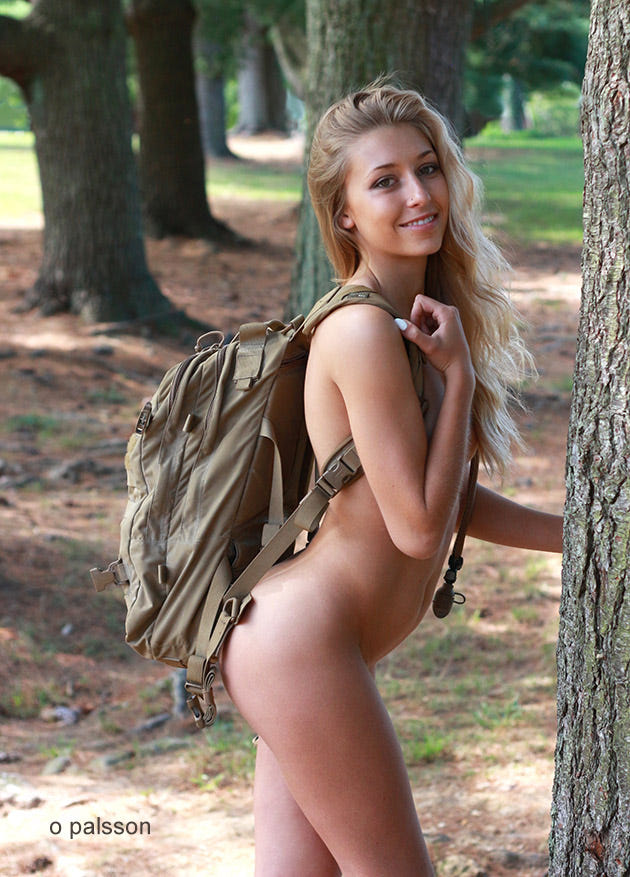 Naked in a backpack