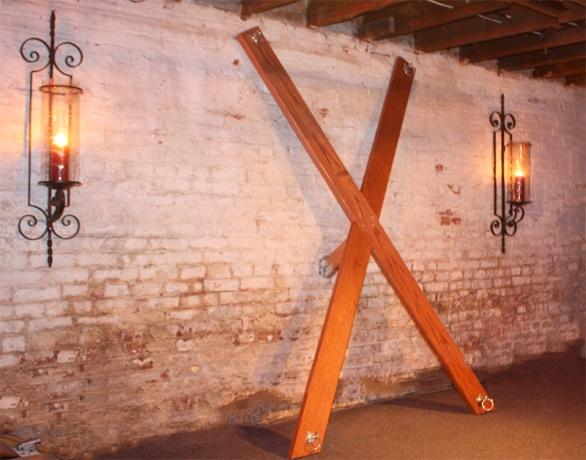 Spanking cross in a dungeon