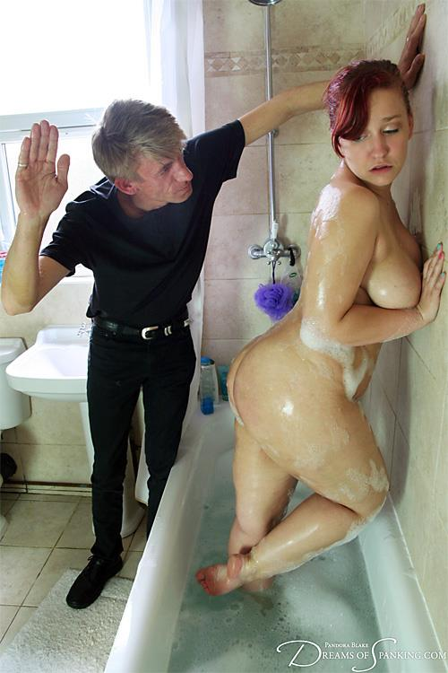 Naked redhead spanked in the bath-tub